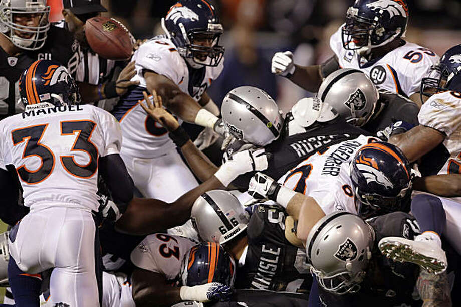 JaMarcus Russell loses the ball on a quarterback sneak in the first quarter, but the raiders were awarded the first down. Oakland Raiders played the Denver Broncos on Monday Night Football at the McAfee Coliseum in Oakland, Calif., on Monday, September 8, 2008. Photo: Carlos Avila Gonzalez, The Chronicle