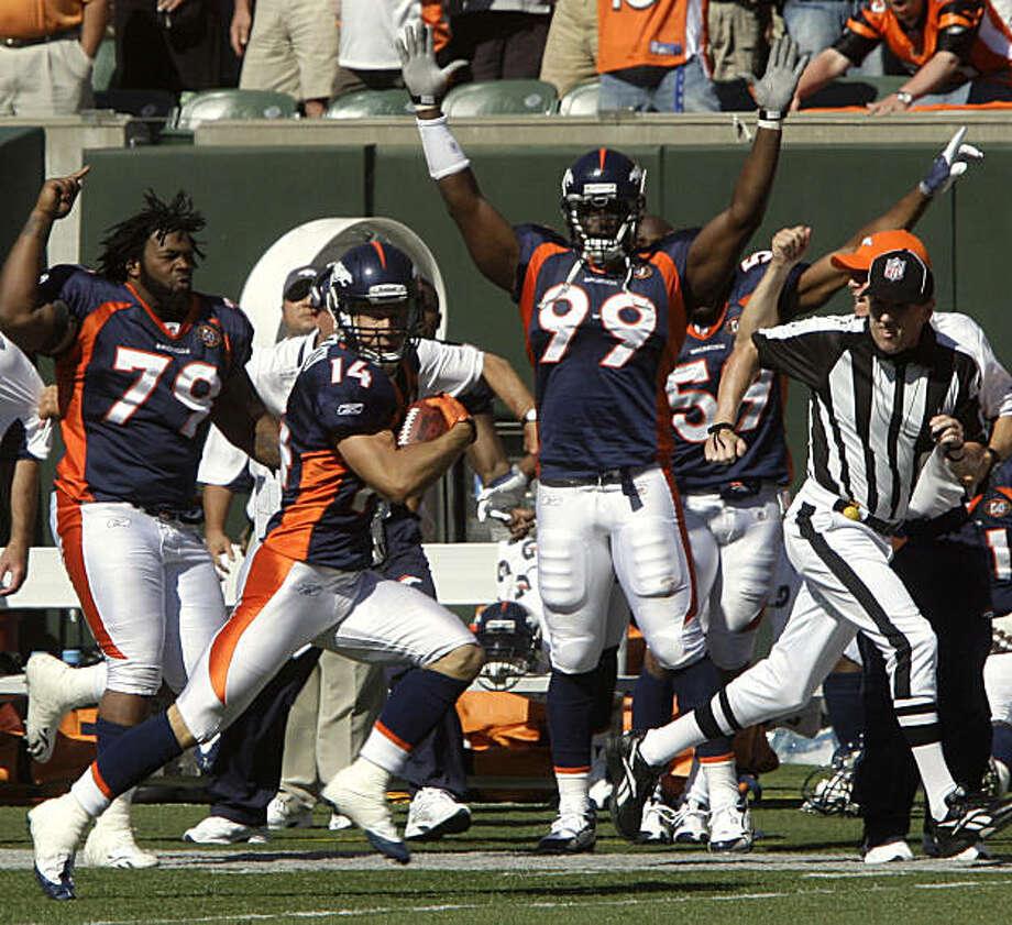 Denver Broncos receiver Brandon Stokley (14) runs for an 87-yard touchdown reception in the fourth quarter of an NFL football game against the Cincinnati Bengals, Sunday, Sept. 13, 2009, in Cincinnati. Denver won the game 12-7. (AP Photo/Al Behrman) Photo: Al Behrman, AP