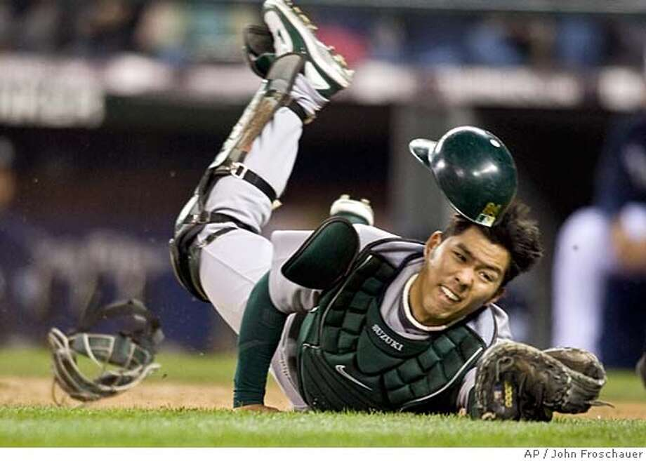 Oakland Athletics catcher makes a diving catch of a pop bunt for an out hit by Seattle Mariners' Ichiro Suzuki during the fifth inning of their baseball game in Seattle on Friday, April 25, 2008. (AP Photo/John Froschauer) Photo: John Froschauer