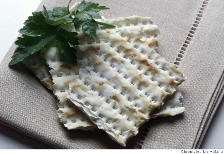 MATZO-C-01MAR02-FD-LH--Matzo  (PHOTOGRAPHED BY LIZ HAFALIA/THE SAN FRANCISCO CHRONICLE)  also ran 03/30/2004  Ran on: 04-04-2007  Matzo, made with only water and flour, is traditionally eaten during the Passover holiday.  ALSO Ran on: 04-06-2007 Photo: LIZ HAFALIA