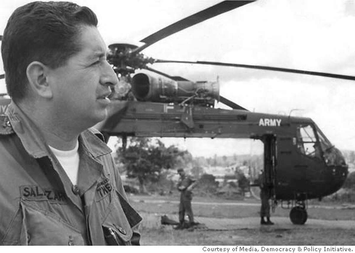 ###Live Caption:Ruben Salazar covers the war in Vietnam for the Los Angeles Times in 1965. Photo courtesy of Media, Democracy & Policy Initiative.###Caption History:Ruben Salazar covers the war in Vietnam for the Los Angeles Times in 1965. Photo courtesy of Media, Democracy & Policy Initiative.###Notes:###Special Instructions:ONE-TIME USE ONLY WITH STORY ON POSTAGE STAMP.