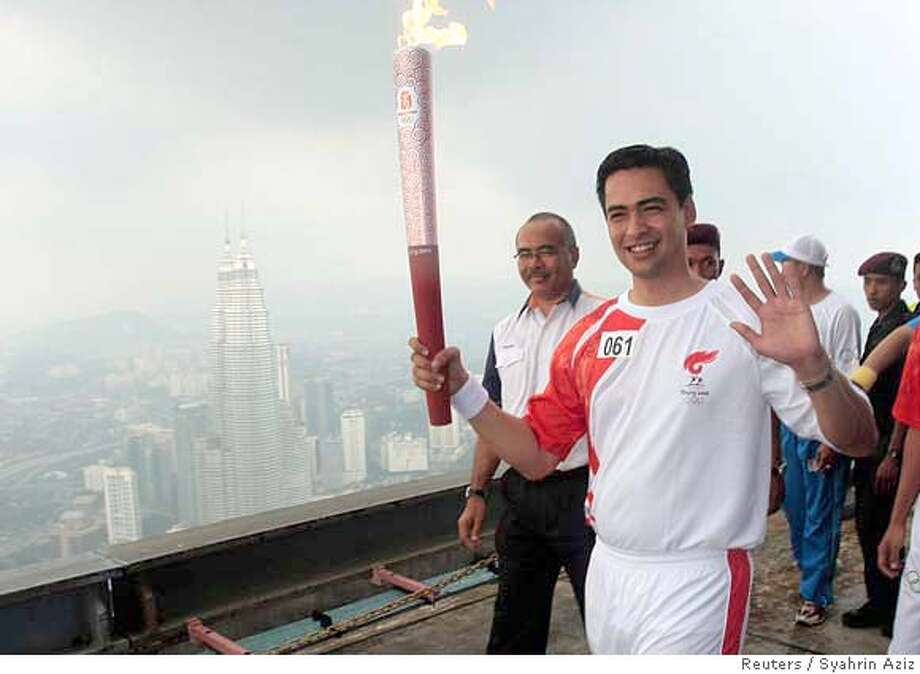 ###Live Caption:Malaysia's astronaut Sheikh Muszaqhar waves as he runs with the Olympic torch on top of Kuala Lumpur's Tower during the Beijing Olympic torch relay April 21, 2008. The Olympic torch was paraded through Malaysia's capital on Monday as authorities kept a tight security, seeking to avoid the kind of chaos that has dogged the relay elsewhere. REUTERS/Syahrin Aziz (MALAYSIA)###Caption History:Malaysia's astronaut Sheikh Muszaqhar waves as he runs with the Olympic torch on top of Kuala Lumpur's Tower during the Beijing Olympic torch relay April 21, 2008. The Olympic torch was paraded through Malaysia's capital on Monday as authorities kept a tight security, seeking to avoid the kind of chaos that has dogged the relay elsewhere. REUTERS/Syahrin Aziz (MALAYSIA)###Notes:Malaysia's astronaut Sheikh Muszaqhar waves as he runs with Olympic torch on top of Kuala Lumpur's Tower during the Beijing Olympic torch relay###Special Instructions:0 Photo: STR