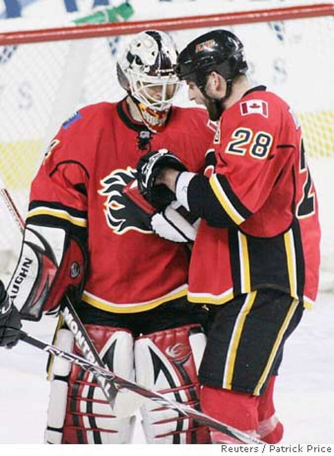 ###Live Caption:Calgary Flames goalie Miikka Kiprusoff is congratulated by Flames Robyn Regehr on the Flames 2-0 win over the San Jose Sharks during Game 6 of their NHL Western Conference quarter-final hockey game in Calgary, Alberta, April 20, 2008. REUTERS/Patrick Price (CANADA)###Caption History:Calgary Flames goalie Miikka Kiprusoff is congratulated by Flames Robyn Regehr on the Flames 2-0 win over the San Jose Sharks during Game 6 of their NHL Western Conference quarter-final hockey game in Calgary, Alberta, April 20, 2008. REUTERS/Patrick Price (CANADA)###Notes:Flames' Kiprusoff is congratulated on 2-0 win over the Sharks during their NHL hockey game in Calgary###Special Instructions:0 Photo: PATRICK PRICE