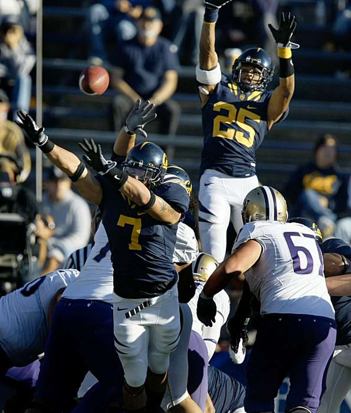 Cal?•s Anthony Felder and Brett Johnson go airborn as they try to block Washington's extra point. Cal defeated Washington 48-7 in there NCAA college football game in Berkeley Saturday, Dec. 6, 2008.