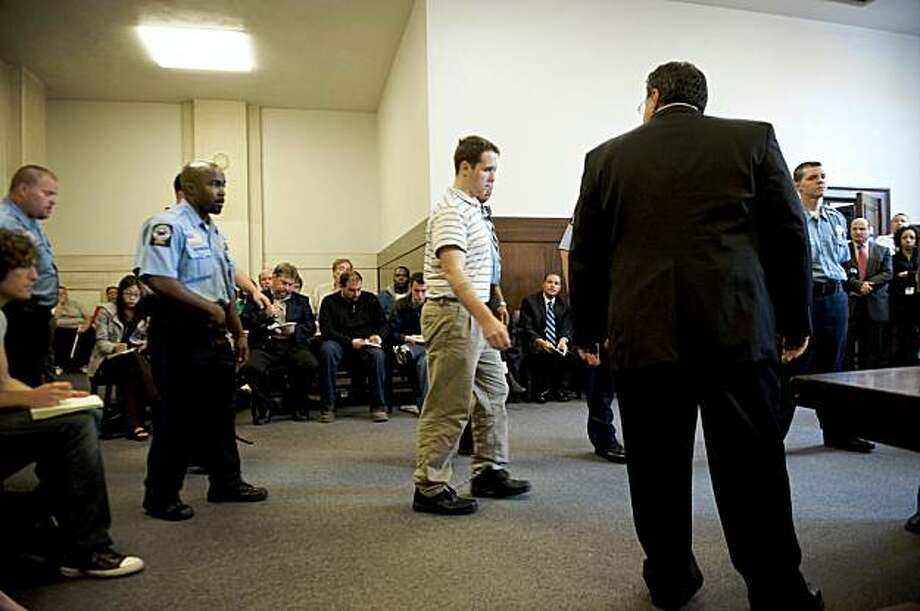 NEW HAVEN, CT - SEPTEMBER 17:  Raymond Clark III (C) is lead into the room as Assistant Public Defender Joseph E. Lopez (R) looks on at his arraignment at the New Haven Superior Court after earlier this morning when he was arrested at a Super 8 Motel in connection with the murder of Yale University graduate student Annie Le on September 17, 2009 in New Haven, Connecticut. Le, whose body was found behind a wall on September 13, in New Haven, Connecticut, had been missing since September 8, after being seen in the morning on surveillance videos entering but not leaving the laboratory building. Raymond Clark III, a lab technician at the Yale laboratory building, was taken into custody from the motel after not resisting arrest by the police as a suspect in the murder of Annie Le. Photo: Douglas Healey, Getty Images