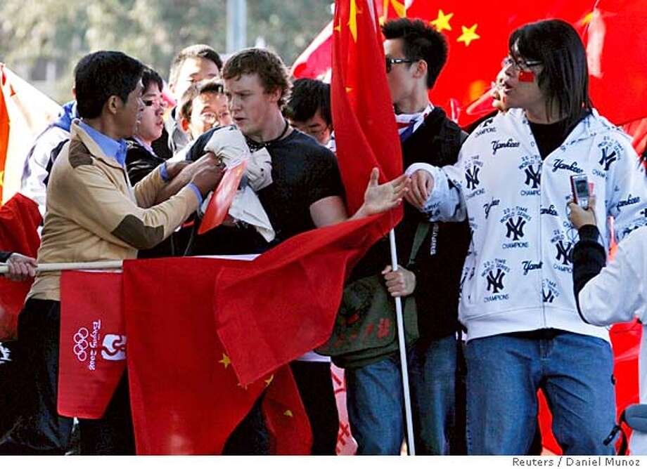 ###Live Caption:A pro-Tibet protester is stopped by supporters of the 2008 Beijing Olympic Games during the Olympic torch relay in Canberra April 24, 2008. REUTERS/Daniel Munoz (AUSTRALIA)###Caption History:A pro-Tibet protester is stopped by supporters of the 2008 Beijing Olympic Games during the Olympic torch relay in Canberra April 24, 2008. REUTERS/Daniel Munoz (AUSTRALIA)###Notes:A pro-Tibet protester is stopped by supporters of the 2008 Beijing Olympic Games during the Olympic torch relay in Canberra###Special Instructions:0 Photo: DANIEL MUNOZ