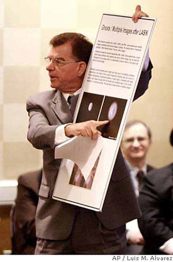 ###Live Caption:David Shell shows a chart of his vision after having Lasik surgery while speaking at a Food and Drug Administration (FDA) hearing in Gaithersburg, Md., Friday, April 25, 2008, to discuss Lasik surgery. (AP Photo/Luis M. Alvarez)###Caption History:David Shell shows a chart of his vision after having Lasik surgery while speaking at a Food and Drug Administration (FDA) hearing in Gaithersburg, Md., Friday, April 25, 2008, to discuss Lasik surgery. (AP Photo/Luis M. Alvarez)###Notes:David Shell###Special Instructions: Photo: Luis M. Alvarez