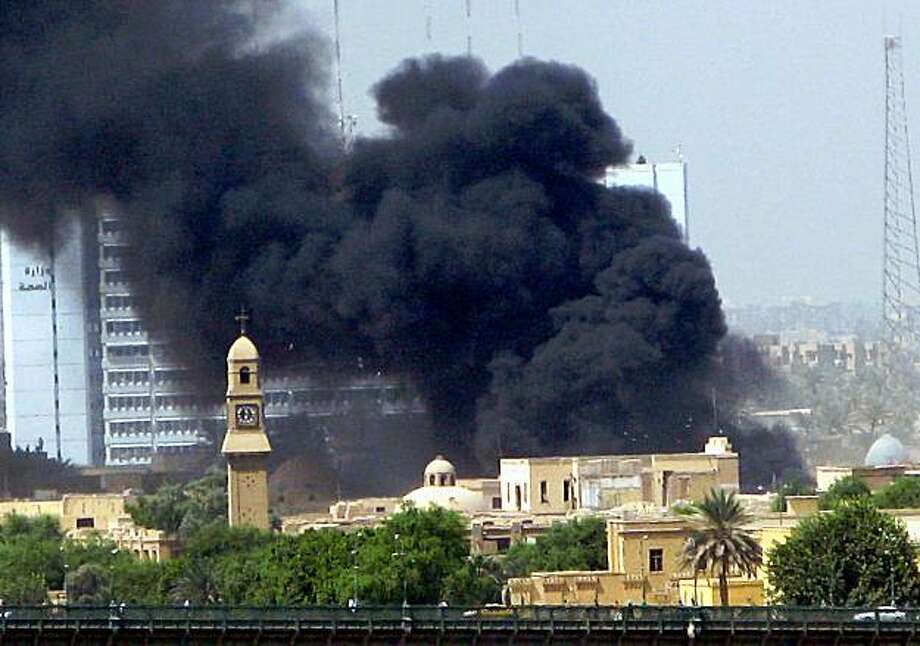 Black smoke billows following an explosion at the Bab al-Muazam district, close to the former Defence Ministry in central Baghdad on September 12, 2009. Photo: STR, AFP/Getty Images