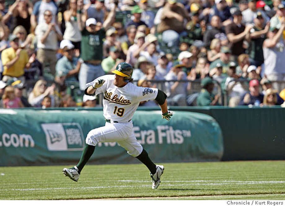 Chris Denorfia turns second base as he scores on a Kurt Suzuki Sinngles up the middle in the 7th. On Saturday April 19 2008 in Oakland, Calif  Photo By Kurt Rogers / San Francisco Chronicle Ran on: 04-20-2008  Chris Denorfia heads for home with the A's lead run after a hit by Kurt Suzuki in the 7th inning. Photo: Kurt Rogers