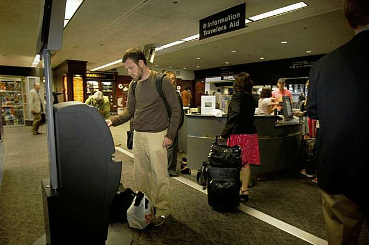 Ari Peskoe of Boston, Mass. uses a carbon offset kiosk in Terminal 3 on the day that SFO unveiled the new kiosks at SFO, Calif. on Thursday, September 17, 2009.