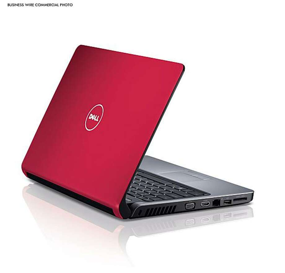 Featuring thinner, lighter body and long-lasting ''power-sipping'' batteries, the new Dell Inspiron 14z in Cherry Red makes it easy to take fun and entertainment on the road for extended periods of time. (Photo: Business Wire) Photo: Lee Kirgan Photography, Business Wire
