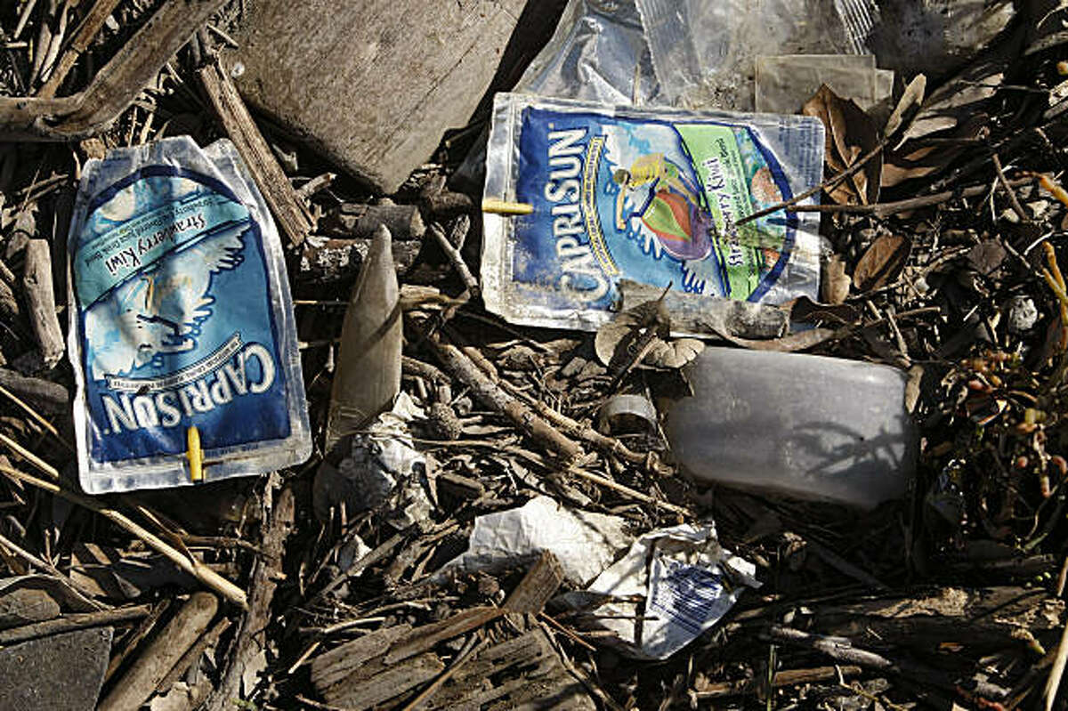 Trash washed up on shore along San Francisco Bay in Emeryville, Calif., on Friday September 11, 2009.