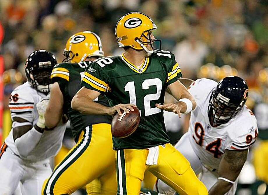 GREEN BAY, WI - SEPTEMBER 13: Aaron Rodgers #12 of the Green Bay Packers looks to pass as Alex Brown #96 and Marcus Harrison #94 of the Chicago Bears rush on September 13, 2009 at Lambeau Field in Green Bay, Wisconsin. (Photo by Jonathan Daniel/Getty Images) Photo: Jonathan Daniel, Getty Images