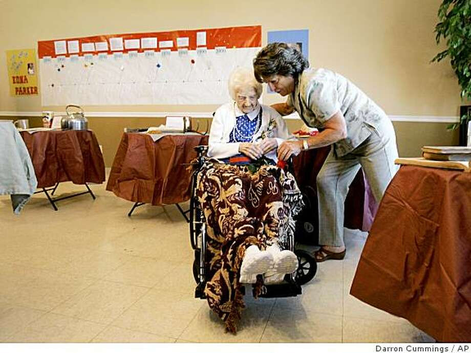 Edna Parker shows her new shoes that she received as a birthday gift to her granddaughter Barbara Saletnig  during a party for Parker in Shelbyville, Ind., Friday, April 18, 2008. Parker, who was born April 20, 1893, is the oldest known human. She will turn 115 on Sunday, April 20, 2008. (AP Photo/Darron Cummings) Photo: Darron Cummings, AP
