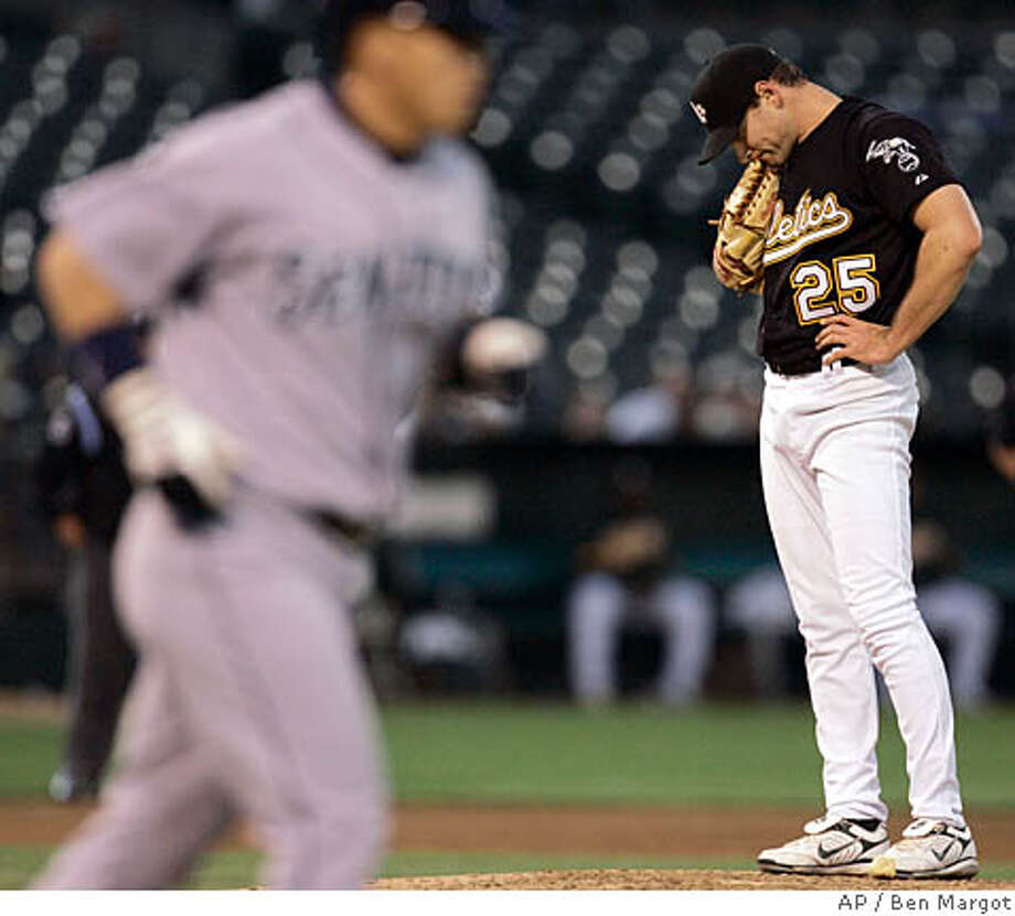 Oakland Athletics pitcher Lenny DiNardo (25) hangs his head after walking Seattle Mariners' Kenji Johjima, left, of Japan, with the bases loaded in the third inning of a baseball game Thursday, April 17, 2008, in Oakland, Calif. (AP Photo/Ben Margot) Photo: Ben Margot