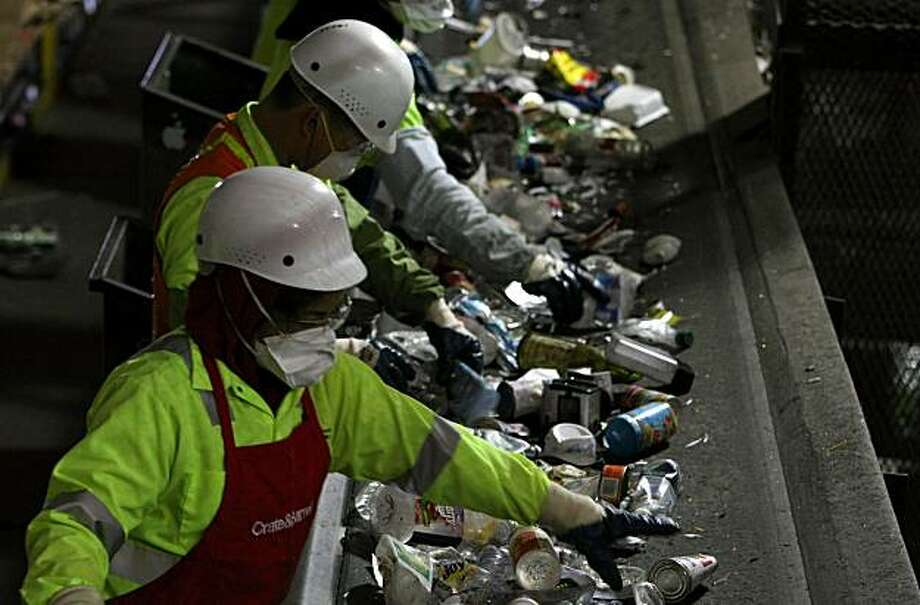 SAN FRANCISCO - APRIL 22:  Workers sort through recycled plastics as they pass on a conveyor belt at the San Francisco Recycling Center April 22, 2008 in San Francisco, California. To Coincide with Earth Day, San Francisco recycling companies, Sunset Scavenger Co. and Golden Gate Disposal & Recycling Co., have started accepting rigid plastics as part of their curbside recycling program. Customers will now be able to recycle rigid plastics such as plastic toys, paint buckets, clamshell containers and plant containers which in the past could not be properly processed. The San Francisco recycling center processes approximately 750 tons of recyclables a day.  (Photo by Justin Sullivan/Getty Images) Photo: Justin Sullivan, Getty Images