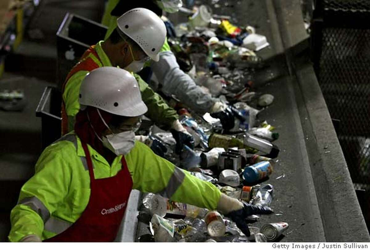 ###Live Caption:SAN FRANCISCO - APRIL 22: Workers sort through recycled plastics as they pass on a conveyor belt at the San Francisco Recycling Center April 22, 2008 in San Francisco, California. To Coincide with Earth Day, San Francisco recycling companies, Sunset Scavenger Co. and Golden Gate Disposal & Recycling Co., have started accepting rigid plastics as part of their curbside recycling program. Customers will now be able to recycle rigid plastics such as plastic toys, paint buckets, clamshell containers and plant containers which in the past could not be properly processed. The San Francisco recycling center processes approximately 750 tons of recyclables a day. (Photo by Justin Sullivan/Getty Images)###Caption History:SAN FRANCISCO - APRIL 22: Workers sort through recycled plastics as they pass on a conveyor belt at the San Francisco Recycling Center April 22, 2008 in San Francisco, California. To Coincide with Earth Day, San Francisco recycling companies, Sunset Scavenger Co. and Golden Gate Disposal & Recycling Co., have started accepting rigid plastics as part of their curbside recycling program. Customers will now be able to recycle rigid plastics such as plastic toys, paint buckets, clamshell containers and plant containers which in the past could not be properly processed. The San Francisco recycling center processes approximately 750 tons of recyclables a day. (Photo by Justin Sullivan/Getty Images)###Notes:On Earth Day, San Francisco Expands Recycling To Rigid Plastics###Special Instructions: