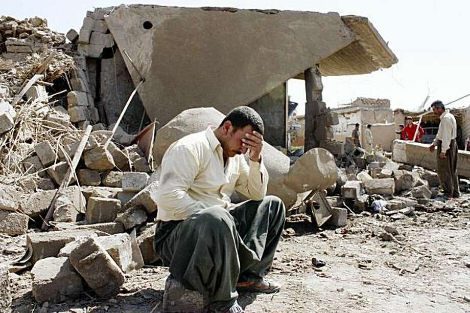 An Iraqi man sits in the ruins of a Kurdish village after a predawn suicide truck bombing in Wardek, about 35 miles (55 kilometers) southeast of Mosul in northern Iraq, Thursday, Sept. 10, 2009. (AP Photo) Photo: AP