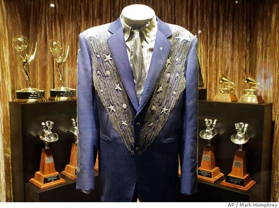"""Clothing and awards owned by country musician Hank Williams Jr. are displayed as part of the exhibit """"Family Tradition: The Williams Family Legacy"""" at the Country Music Hall of Fame and Museum in Nashville, Tenn., on March 27, 2008. The exhibit includes items from the careers of Hank Williams, Hank Williams Jr., and other members of the Williams family. (AP Photo/Mark Humphrey) Photo: Mark Humphrey"""