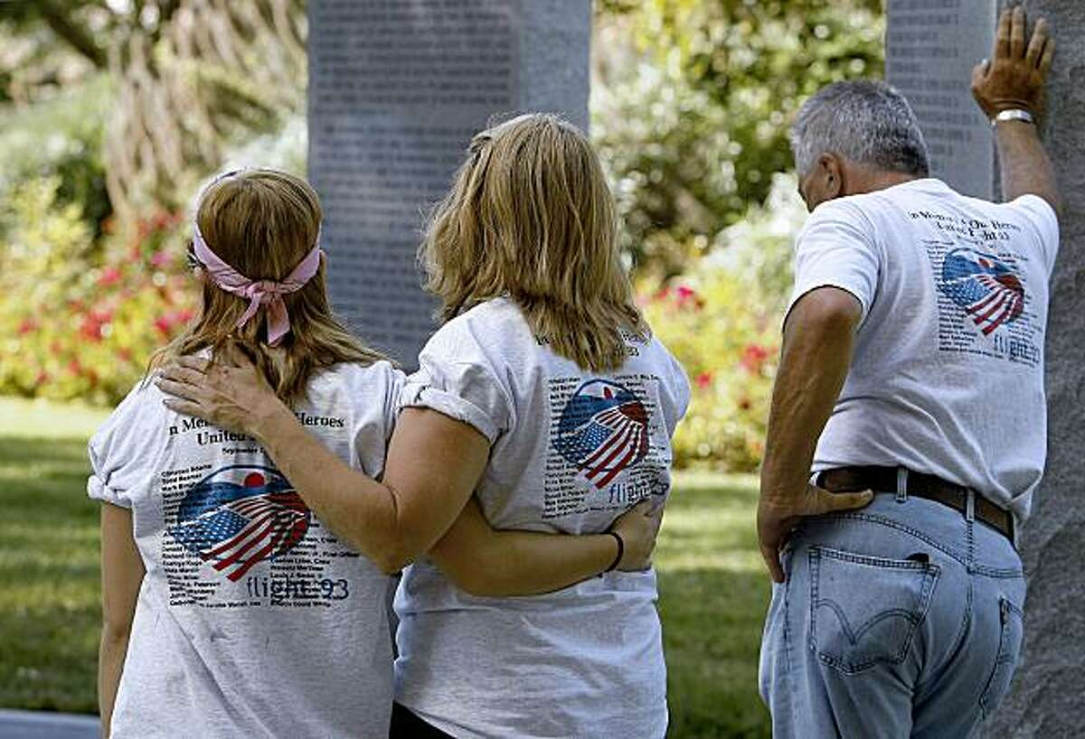 """Courtney Nacke and her Mom Marci, (neice and sister-in-law to Louis Nacke), reflect at the Union cIty, Calif. Memorial to those lost on flight 93 which crashed in 2001 during the Sept. 11th terrorist attacks. Hank """"Detroit"""" Kinsey also nearby. Louis Nacke never finished his final trip from Philadelphia to San Francisco, on Sept. 11, 2001, terrorists hijacked Nacke's flight and crashed the plane, now brothers and cousins are finishing their trip on the next-to-last leg, from Reno to the Flight 93 memorial in Union City, Calif., on Thursday September 10, 2009."""