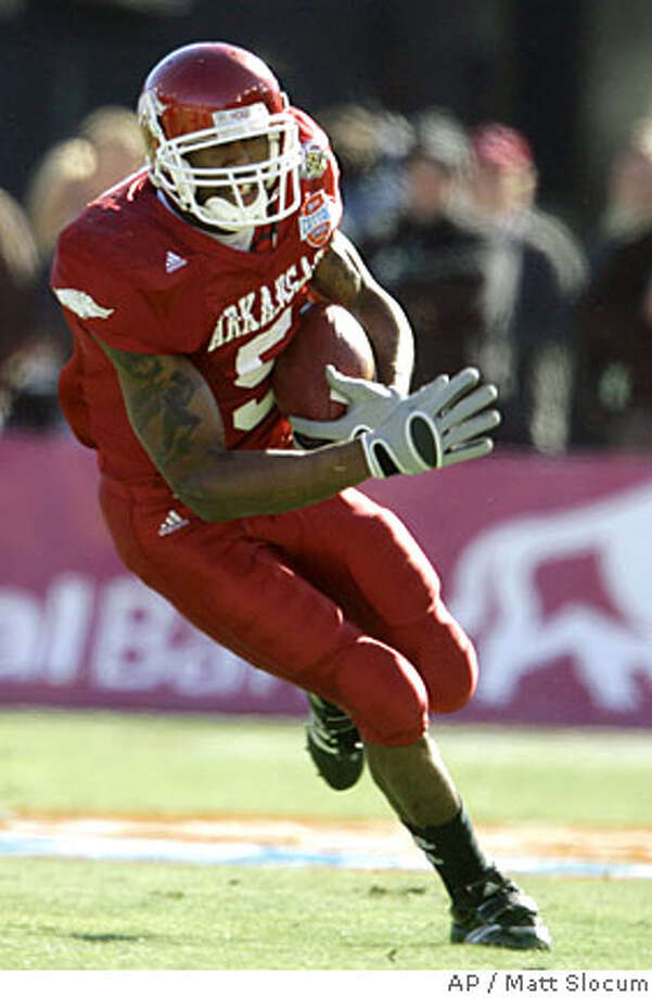 ** FOR USE AS DESIRED WITH 2008 NFL DRAFT STORIES ** FILE ** In this Jan. 1, 2008 file photo, Arkansas tailback Darren McFadden (5) carries the ball against Missouri during the first quarter of the Cotton Bowl college football game in Dallas. McFadden is a top prospect in the 2008 NFL Draft. (AP Photo/Matt Slocum, File) Photo: Matt Slocum