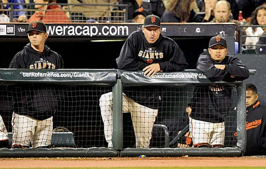 Randy Johnson looks on from the dugout as the Giants get pounded by the Dodgers. Photo: Frederic Larson, The Chronicle