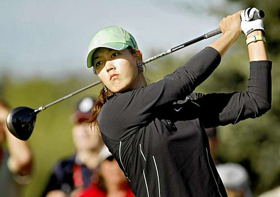 Michelle Wie watches her tee shot on the 12th hole during the second round at the LPGA Canadian Open at Priddis Greens,  near Calgary, Alberta, Friday, Sept. 4, 2009. (AP Photo/The Canadian Press, Jeff McIntosh) Photo: Jeff McIntosh, AP