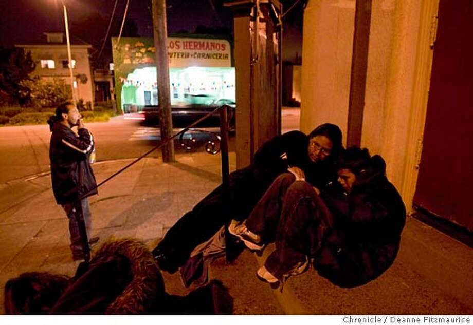 Martha Weasel Bear, 38, a Native American, helps her son Carl, 11, with his homework under the streetlight of Fruitvale Christian Church at 9pm on March 19, 2008 in Oakland, Calif. Carl's father, Phillip Moreno, 37, smokes a cigarette in the background. They are waiting at Fruitvale Christian Church for the homeless preacher to arrive, deliver a sermon on these steps of the church and hand out free blankets. They are homeless and an example of tribal people who are not benefitting from casino money.  Photo by Deanne Fitzmaurice / San Francisco Chronicle Ran on: 04-20-2008  Martha Weaselbear, her husband, Phillip Moreno, and their son Carl walk along International Boulevard in Oakland. Weaselbear says she and her husband joke: &quo;Hey, where's all our money?&quo; Photo: Deanne Fitzmaurice