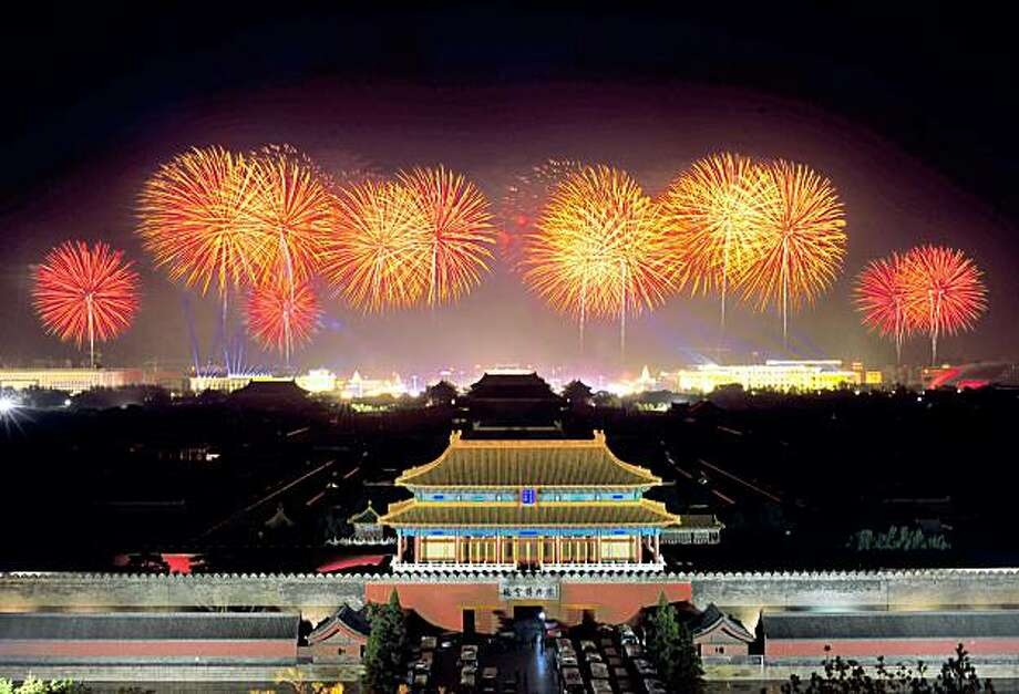 A fireworks display rehearsal lights up the Forbidden City beside Tiananmen Square in Beijing on September 12, 2009. China will stage a huge military parade and pageant in Beijing on October 1 to celebrate the 60th anniversary of the founding of communist China.        CHINA OUT  AFP PHOTO (Photo credit should read AFP/AFP/Getty Images) Photo: AFP, AFP/Getty Images