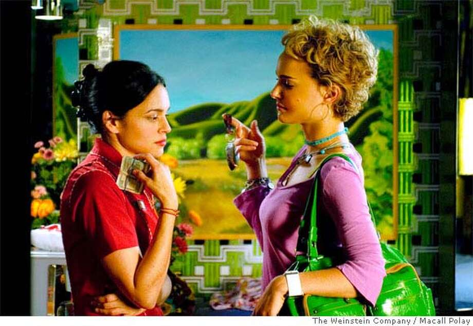 "This undated photo provided by The Weinstein Company shows Norah Jones, left, and Natalie Portman in a scene from Wong Kar Wai's ""My Blueberry Nights."" (AP Photo/The Weinstein Company, Macall Polay) **NO SALES** Photo: Macall Polay"