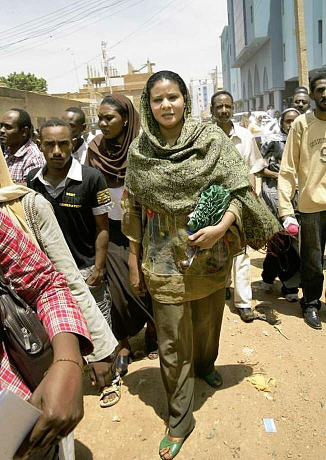 Sudanese journalist and U.N. staffer Lubna Hussein, wearing the same trousers that had sparked her arrest, arrives at the court where she was convicted of violating the public indecency law by wearing trousers outdoors and fined US$ 200, in Khartoum, Sudan Monday, Sept. 7, 2009. Lubna Hussein was among 13 women arrested July 3 in a raid by the public order police after which ten of the women were fined and flogged two days later, but Hussein said Friday she would rather go to jail than pay any fine, out of protest at the nation's strict laws on women's dress. (AP Photo/Abd Raouf) Photo: Abd Raouf, AP