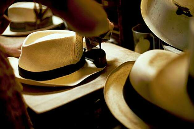 Abbie Dwelle, one of the owners of Paul's Hat Works, works on a brim of a hat. Photo: Stephen Lam, The Chronicle