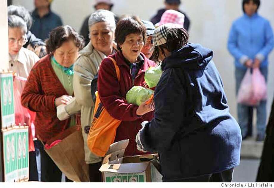 ###Live Caption:Venus Wheatley handing out cabbage for the San Francisco Food Bank at Ping Yuen during a senior food giveaway in Chinatown in San Francisco, Calif. on Monday, April 21, 2008. Federal budget cuts make it difficult to restore an already cut program, where seniors who get less that $1,100 a month were given food boxes once a month.  Photo by Liz Hafalia / San Francisco Chronicle###Caption History:Venus Wheatley handing out cabbage for the San Francisco Food Bank at Ping Yuen during a senior food giveaway in Chinatown in San Francisco, Calif. on Monday, April 21, 2008. Federal budget cuts make it difficult to restore an already cut program, where seniors who get less that $1,100 a month were given food boxes once a month.  Photo by Liz Hafalia / San Francisco Chronicle###Notes:Venus Wheatley handing out cabbage for the San Francisco Food Bank at Ping Yuen during a senior food giveaway in Chinatown in San Francisco, Calif. on Monday, April 21, 2008. Federal budget cuts make it difficult to restore an already cut program, where###Special Instructions:�2008, San Francisco Chronicle/ Liz Hafalia  MANDATORY CREDIT FOR PHOTOG AND SAN FRANCISCO CHRONICLE. NO SALES- MAGS OUT. Photo: Liz Hafalia