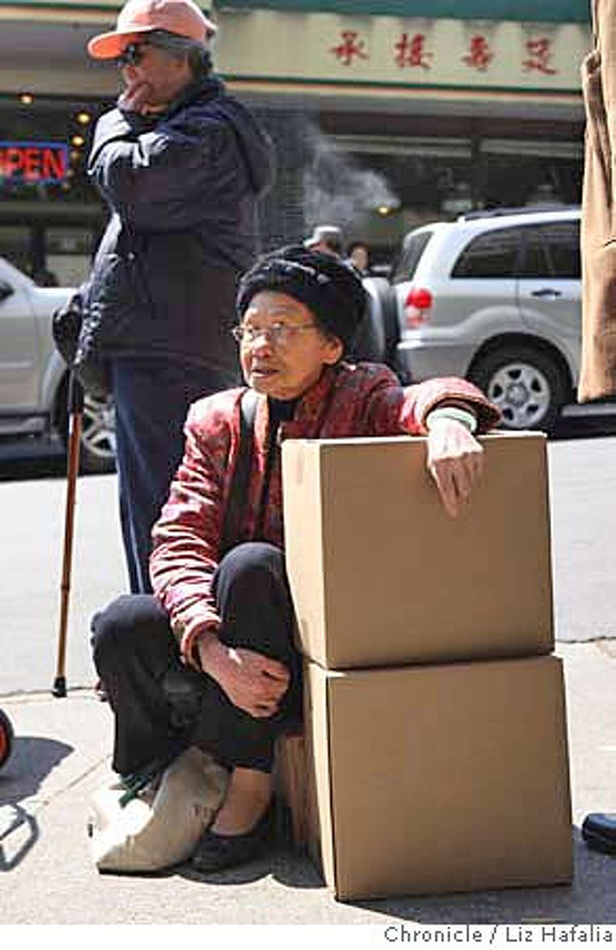 ###Live Caption:Shu Hing Seto Wu, 80 years old, waiting by her food boxes at Ping Yuen in Chinatown in San Francisco, Calif., as the San Francisco Food Bank does a senior food giveaway on Monday, April 21, 2008. Federal budget cuts make it difficult to restore an already cut program, where seniors who get less that $1,100 a month were given food boxes once a month. Liz Hafalia / The Chronicle / {city } / 4/21/08 **Shu Hing Seto Wu cq Photo by Liz Hafalia / San Francisco Chronicle###Caption History:Shu Hing Seto Wu, 80 years old, waiting by her food boxes at Ping Yuen in Chinatown in San Francisco, Calif., as the San Francisco Food Bank does a senior food giveaway on Monday, April 21, 2008. Federal budget cuts make it difficult to restore an already cut program, where seniors who get less that $1,100 a month were given food boxes once a month. Liz Hafalia / The Chronicle / {city } / 4/21/08 **Shu Hing Seto Wu cq Photo by Liz Hafalia / San Francisco Chronicle###Notes:Shu Hing Seto Wu, 80 years old, waiting by her food boxes at Ping Yuen in Chinatown in San Francisco, Calif., as the San Francisco Food Bank does a senior food giveaway on Monday, April 21, 2008. Federal budget cuts make it difficult to restore an alre###Special Instructions:�2008, San Francisco Chronicle/ Liz Hafalia MANDATORY CREDIT FOR PHOTOG AND SAN FRANCISCO CHRONICLE. NO SALES- MAGS OUT.
