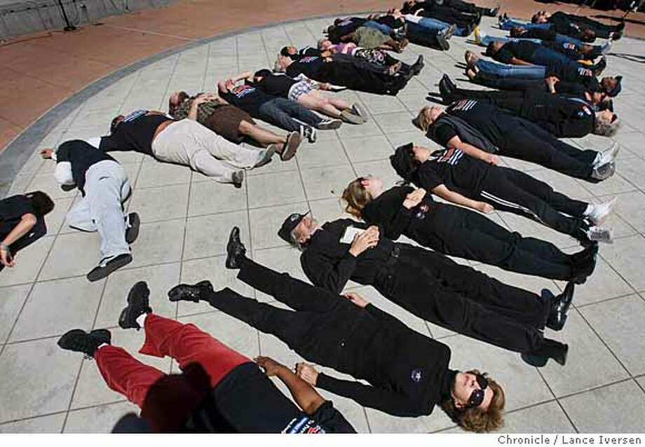 On the one-year anniversary of the Virginia Tech massacre concerned citizens and survivors of gun violence along with Laney College students held a Lie-In on the campus quad in memory of victims. One hundred protest nation-wide were held Wednesday drawing attention to several bills is support for gun law reform including two in California, Photographed in Oakland Calif, Wednesday April 16, 2008. Photo By Lance Iversen/ San Francisco Chronicle Ran on: 04-17-2008  Laney College students, gun violence survivors and others participate in a &quo;lie-in&quo; on the Laney campus quad in Oakland Wednesday to call for tougher gun laws. Lie-ins were held across the country to mark the anniversary of last year's deadly Virginia Tech shooting and to protest U.S. gun violence. Photo: LANCE IVERSEN