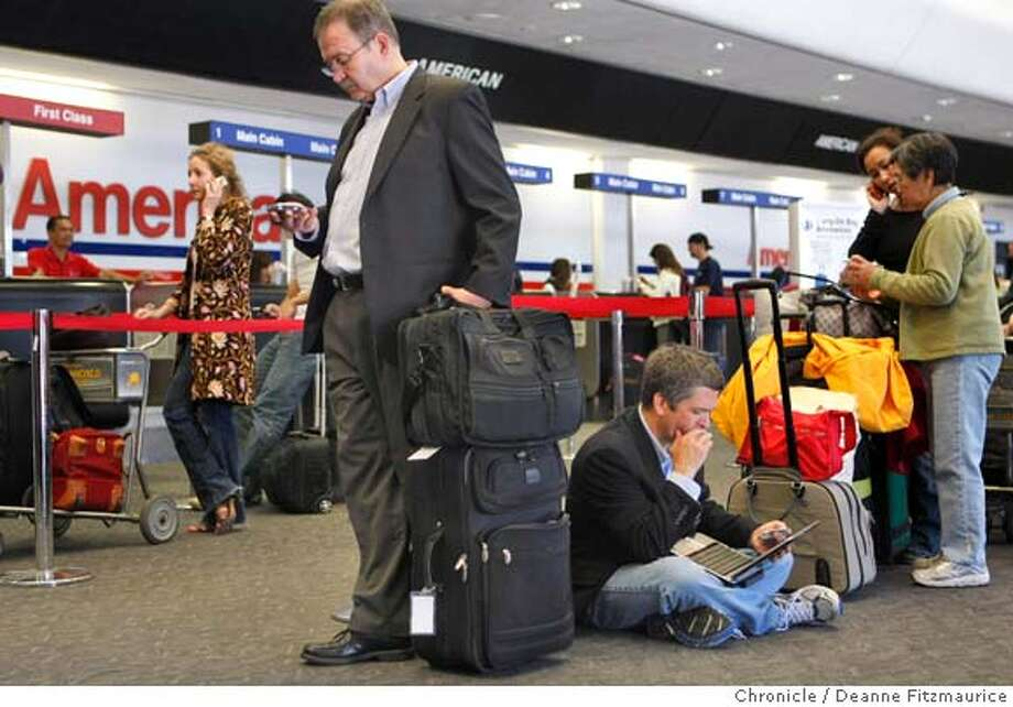 These people waited in line for two hours as Midwest airline cancelled flights as well as American Airlines causing long lines at San Francisco International Airlines on April 9, 2008 in South San Francisco, Calif. Photo by Deanne Fitzmaurice / San Francisco Chronicle Photo: Deanne Fitzmaurice