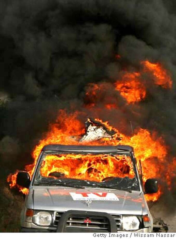 ###Live Caption:AL-BURIJ, GAZA STRIP - APRIL 16: The car of Reuters cameraman Fadel Shaana (not pictured) is engulfed in flames after it was hit by an Israeli missile on April 16, 2008 in central Gaza Strip. The Israeli air strike killed the Palestinian cameraman working for the Reuters news service, and at least 11 others, including Palestinian children and women, medics and witnesses said. According to reports three Israeli soldiers also died today. (Photo by Wissam Nassar/Getty Images)###Caption History:AL-BURIJ, GAZA STRIP - APRIL 16: The car of Reuters cameraman Fadel Shaana (not pictured) is engulfed in flames after it was hit by an Israeli missile on April 16, 2008 in central Gaza Strip. The Israeli air strike killed the Palestinian cameraman working for the Reuters news service, and at least 11 others, including Palestinian children and women, medics and witnesses said. According to reports three Israeli soldiers also died today. (Photo by Wissam Nassar/Getty Images)###Notes:Israeli Missile Kills Cameraman As Violence Erupts In Gaza###Special Instructions: Photo: Getty Images