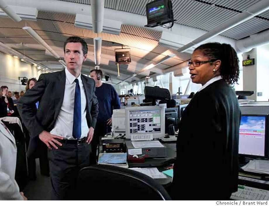 ###Live Caption:Mayor Gavin Newsom, left, and Battalion Chief Khai Ali, who works at the fire dispatch area in the 911 center, met as Newsom took a tour of the facility. San Francisco Mayor Gavin Newsom opened the newly remodeled Emergency Operations Center and visited with 911 dispatchers at their Turk Street headquarters Wednesday, April 16, 2008. Photo by Brant Ward / San Francisco Chronicle###Caption History:Mayor Gavin Newsom, left, and Battalion Chief Khai Ali, who works at the fire dispatch area in the 911 center, met as Newsom took a tour of the facility. San Francisco Mayor Gavin Newsom opened the newly remodeled Emergency Operations Center and visited with 911 dispatchers at their Turk Street headquarters Wednesday, April 16, 2008. Photo by Brant Ward / San Francisco Chronicle###Notes:###Special Instructions: Photo: Brant Ward