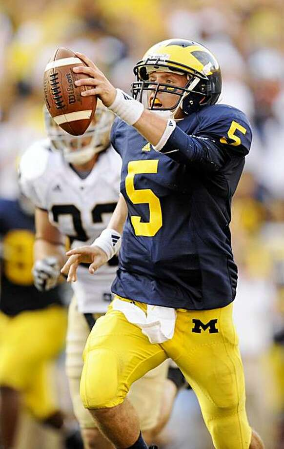 Michigan quarterback Tate Forcier (5) reacts as he out runs Notre Dame safety Harrison Smith (22) to score a touchdown run during the fourth quarter of an NCAA college football game, Saturday, Sept. 12, 2009, in Ann Arbor. (AP Photo/, The Detroit News, John T. Greilick) ** DETROIT FREE PRESS OUT ** Photo: John T. Greilick, AP