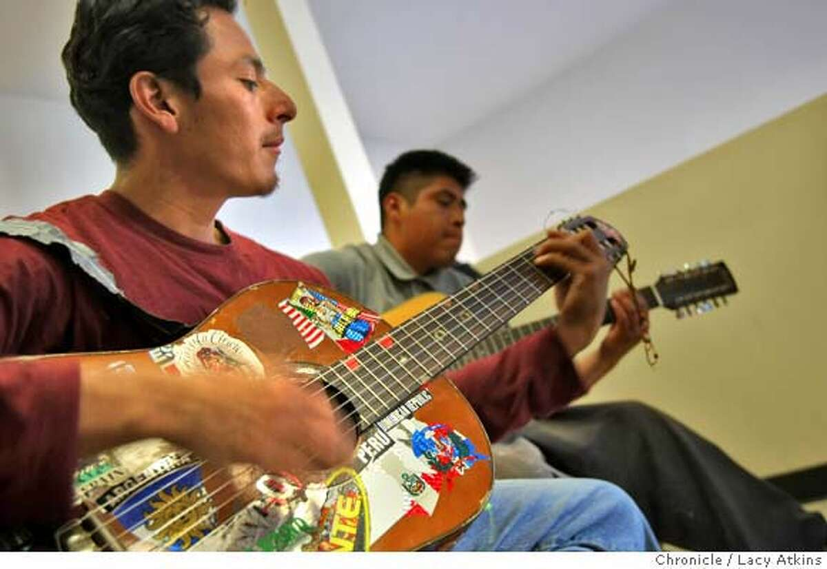 Salvador Perez and Carlos Lopez play the guitars as they practice for the choir, Thursday April 3, at the La Raza Centro in San Francisco, Calif. Lacy Atkins / San Francisco Chronicle