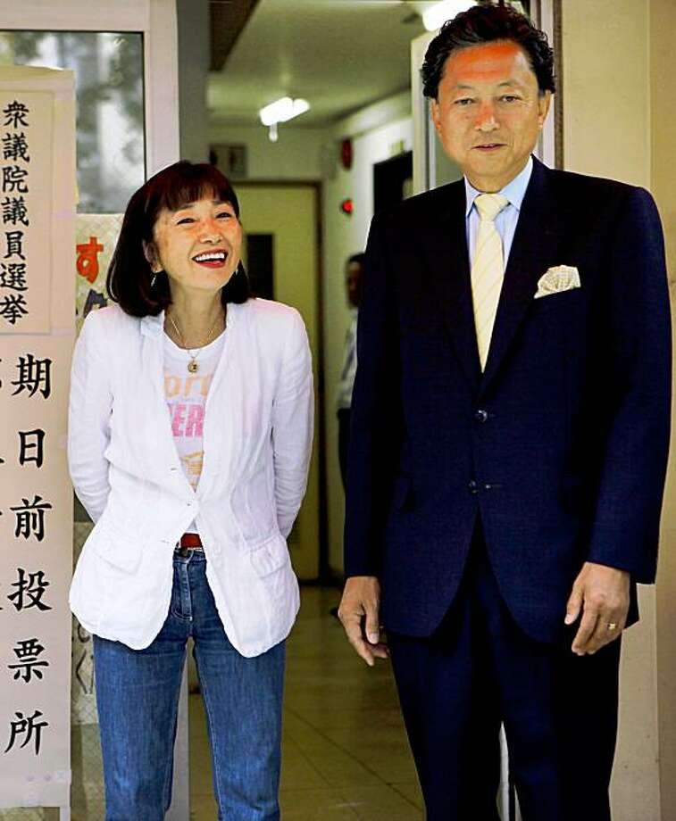 Yukio Hatoyama, right, leader of the main opposition Democratic Party of Japan, and his wife Miyuki smile for the media after casting their absentee votes for the Aug. 30 general elections at a polling station in Tokyo, Japan, Wednesday, Aug. 26, 2009. (AP Photo/Itsuo Inouye) Photo: Itsuo Inouye, AP