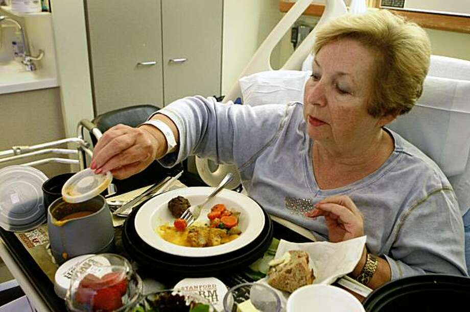 Stanford Hospital & Clinics patient Barbara Stewart of Modesto lifts the lid of a soup container while eating her Farm Fresh meal in her room in Stanford, Calif. on Wednesday, August 26, 2009. Photo: Lea Suzuki, The Chronicle