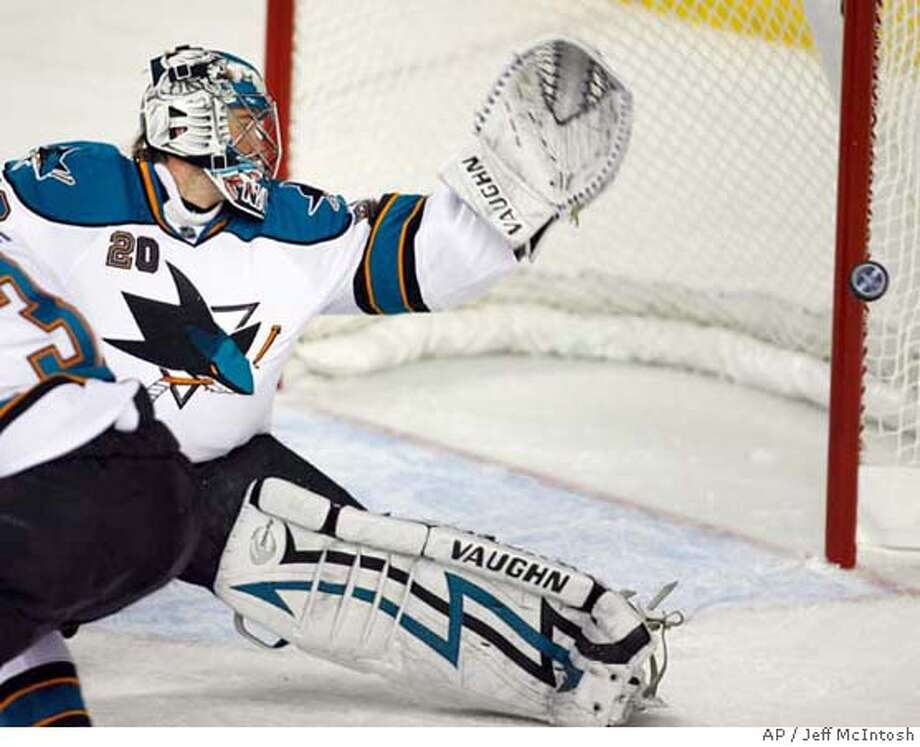 San Jose Sharks goalie Evgeni Nabokov, of Kazakhstan, watches the puck go wide of the net during first period NHL Western Conference quarterfinal hockey action against the Calgary Flames in Calgary, Alberta on Tuesday, April 15, 2008. (AP Photo/The Canadian Press, Jeff McIntosh) Photo: Jeff McIntosh
