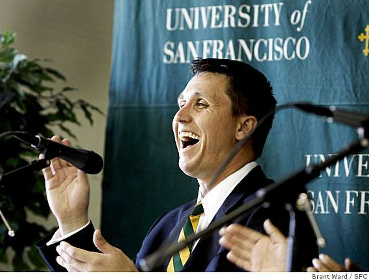 New USF basketball coach Rex Walters laughs at a comment by former coach Jim Brovelli.
