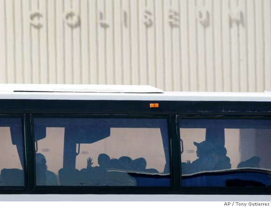 ###Live Caption:The hand of a child, a member of the Fundamentalist Church of Jesus Christ of Latter Day Saints, is seen up against the window of a bus members of tje group arrive at the San Angelo Coliseum after being relocated their from Fort Concho National Historic Landmark in San Angelo, Texas, Monday April 14, 2008. (AP Photo/Tony Gutierrez)###Caption History:The hand of a child, a member of the Fundamentalist Church of Jesus Christ of Latter Day Saints, is seen up against the window of a bus members of tje group arrive at the San Angelo Coliseum after being relocated their from Fort Concho National Historic Landmark in San Angelo, Texas, Monday April 14, 2008. (AP Photo/Tony Gutierrez)###Notes:###Special Instructions: Photo: Tony Gutierrez