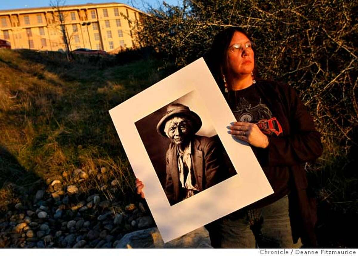 ###Live Caption:With the new Chukchansi Gold Resort and Casino in the background, Cathy Corey holds a photograph of her great, great, great, great grandfather, a leader of the Chukchansi people in the mid to late 1800's who is sometimes referred to as