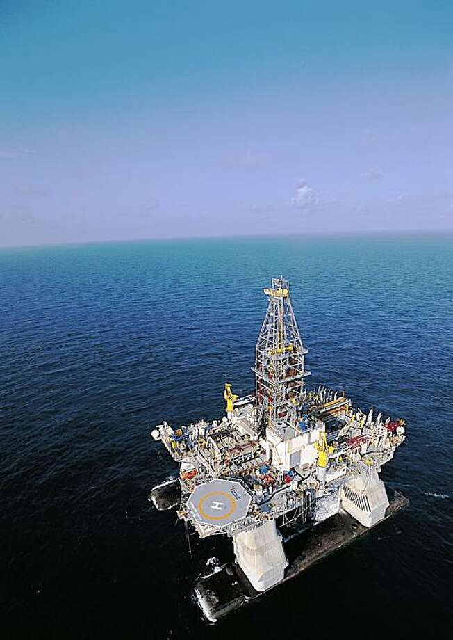 ** ADDS THAT THIS IS THE OIL RIG USED TO DRILL AT THE TIBER WELL ** In this undated photo released by Transocean, the ultra-deepwater semi-submersible rig Deepwater Horizon, which drilled the Tiber well, is shown operating in the U.S. Gulf of Mexico. The Tiber well was drilled to a total depth of 35,055 feet (10,685 meters), making it one of the deepest wells ever drilled by the oil and gas industry, BP said Tuesday, Sept. 2, 2009. (AP Photo/Transocean) ** NO SALES ** Photo: AP