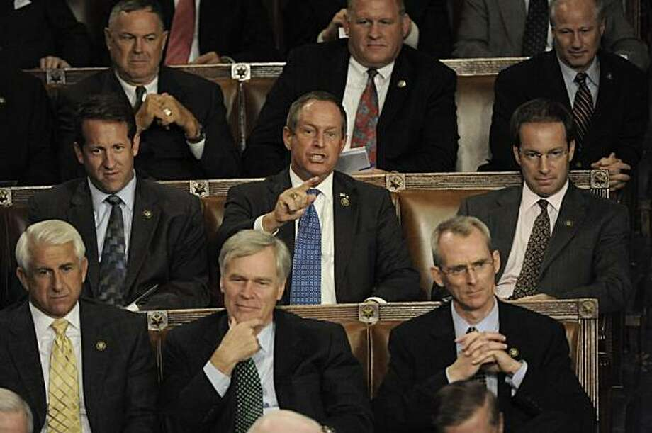 In this Wednesday Sept. 9, 2009, Rep. Joe Wilson, R-S.C., center, points as President Barrack Obama addresses a Joint Session of Congress concerning healthcare, in Washington. (AP Photo/The Washington Post, Melina Mara)   WASHINGTON TIMES OUT; NEW YORK TIMES OUT;USA TODAY OUT; DC EXAMINER OUT; NO SALES; NO ARCHIVES; NO MAGS; MANDATORY CREDIT Photo: Melina Mara, AP