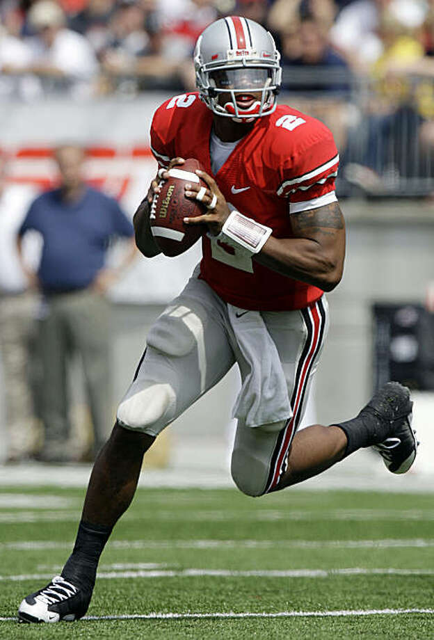FILE - In this Sept. 5, 2009, file photo, Ohio State's Terrelle Pryor rolls out against Navy during an NCAA football game in Columbus, Ohio. Eighth-ranked Ohio State hosts No 3 Southern California on Saturday, Sept. 12. (AP Photo/Jay LaPrete, File) Photo: Jay LaPrete, AP