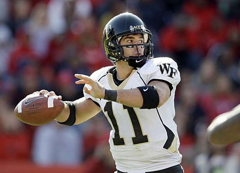 FILE -- This is an Oct. 18, 2008, file photo showing Wake Forest quarterback Riley Skinner throwing a pass during the second half of an NCAA college football game, in  College Park, Md. Riley Skinner has done just about everything during three years at Wake Forest. He's won an ACC title, a pair of bowls and more games than any other quarterback in Demon Deacons history. (AP Photo/Rob Carr, File) Photo: Rob Carr, AP